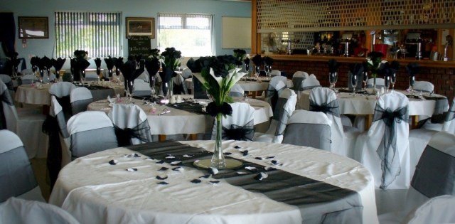 Tables set for a dinner at the Wychbury Room venue